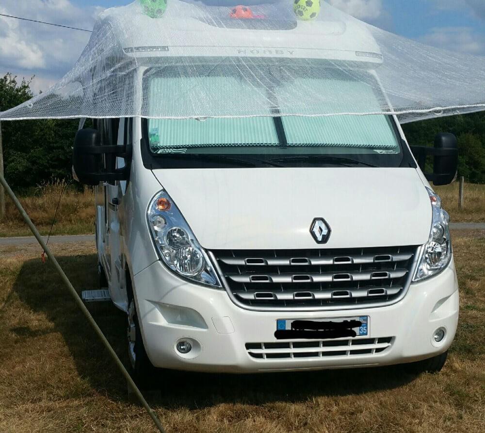 Filet anti grêle installé sur le camping car