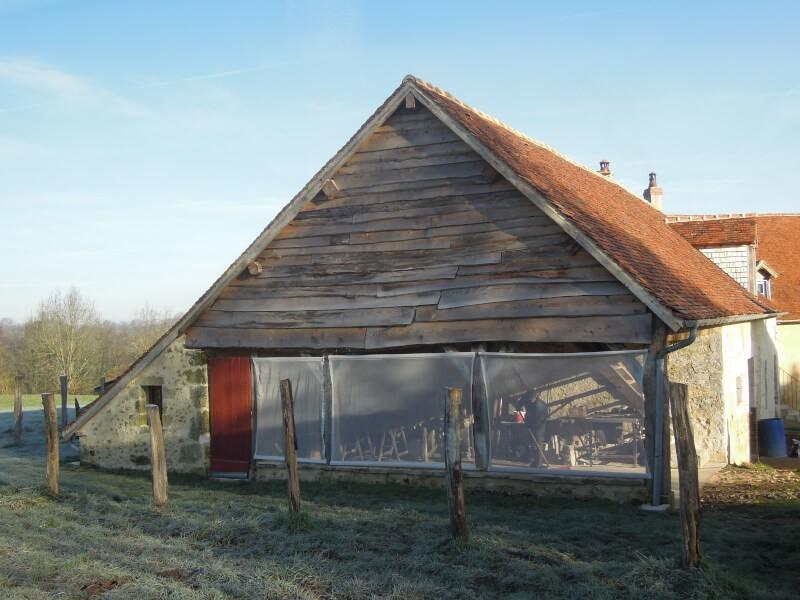 Brise-vent pour grange ouverte