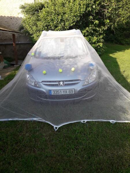 Protéger sa voiture avec un filet anti-grêle