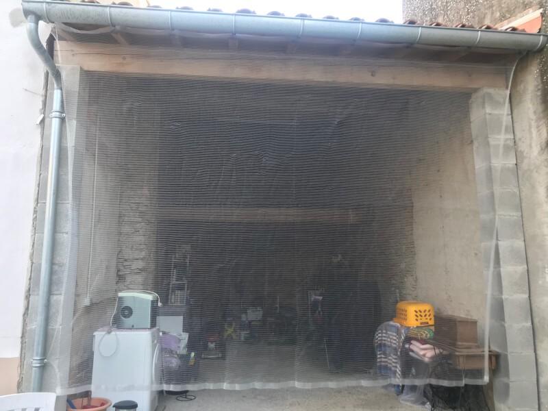Filet anti pigeons pour garage ouvert