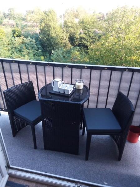 Filet brise-vue gris clair vue depuis un balcon