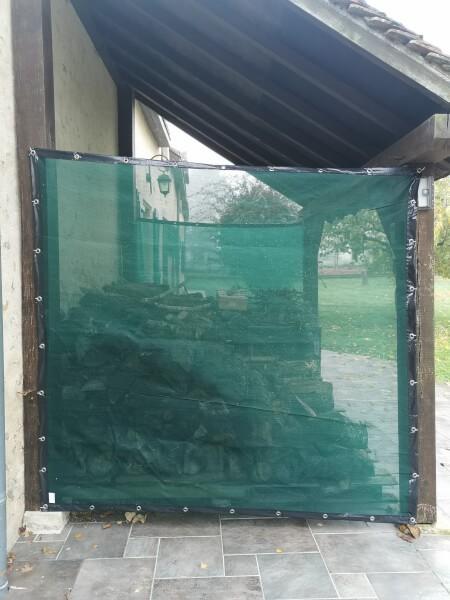 Filet brise-vent pour protéger le bois des intempéries