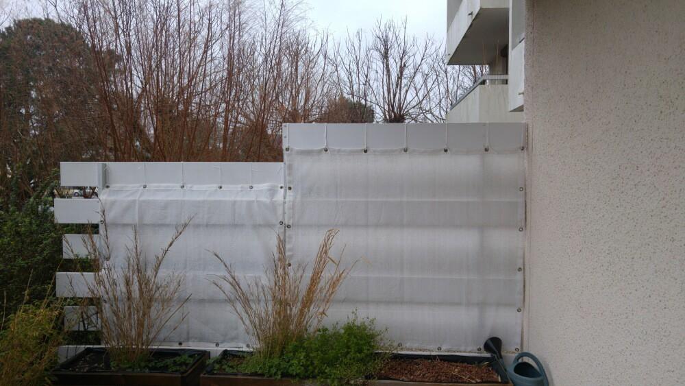 Filet brise-vue blanc pour séparation entre 2 terrasses