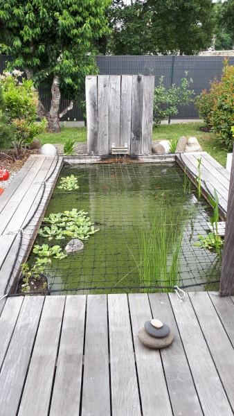 Sécurisation d'un bassin à poissons avec un filet sur-mesure